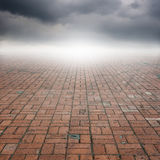 Old brick floor and rainclouds for background Royalty Free Stock Photos