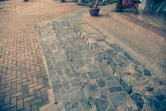 Old brick footpath background walk way. vintage tone Royalty Free Stock Photo