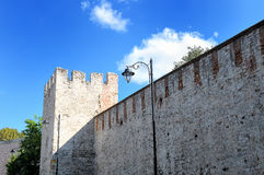 Old brick fortress wall and fortress tower Stock Photos