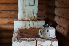 Old brick furnace with teapot Stock Photo