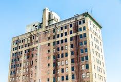 Old Brick Hotel with Dark Windows Stock Photos