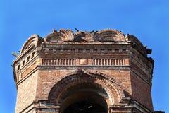 Old brick house. On blue sky background Royalty Free Stock Photo