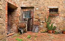 The old brick house with cacti and truck Royalty Free Stock Photography