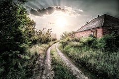 Old brick house near the road in the village Stock Photography
