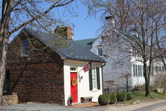 Old brick house with a red door. Two old white brick houses in a country Stock Photography