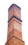 Old brick industrial chimney isolated on white Royalty Free Stock Image