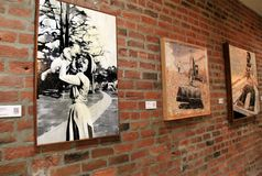 Beautiful brick wall with local art display running length of it, Old 77 Hotel and Chandlery, New Orleans, 2016 stock photo