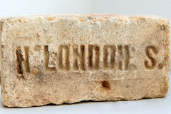Old brick LondonAncient stone from LondonThe inscription on the. Old brick London Ancient stone from London The inscription on the subject of London Royalty Free Stock Photo