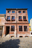 Old brick-made tenement house. Old style brick-made tenement house stock photography