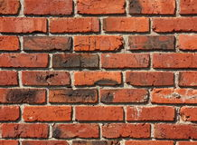 Old Brick and Mortar Wall Pattern. A wall of older red bricks with white mortar, aged and stained over the years royalty free stock image