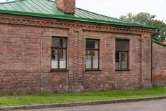 Old brick one-storey house. stock photos