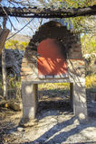 Old brick oven. Under a tin roof Royalty Free Stock Photos