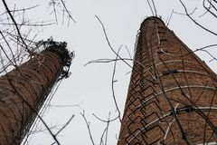 Old brick pipe of the boiler house without smoke. royalty free stock images