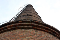 Old brick pipe. The old brick pipe from a red brick goes to the sky Stock Photo