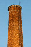 Old brick pipe. It is a top of an old factory pipe. It is made of a brick in the 19th century. The factory still works Royalty Free Stock Images