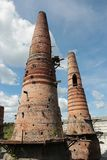 Old brick pipes of factory in Ruskeala, Karelia republic, Russia. Old brick pipes of abandoned marble factory in Ruskeala, Karelia republic, Russia stock images