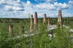 Old brick pipes of factory in Ruskeala, Karelia republic, Russia. Old brick pipes of abandoned marble factory in Ruskeala, Karelia republic, Russia Royalty Free Stock Images