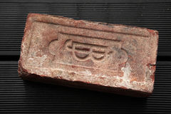 Old brick produced in the Austro-Hungarian Empire. Stock Photos