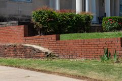 Free Old Brick Retaining Wall In Front Of Newer Red Brick Retaining Wall Stock Photos - 145858343