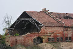 Old brick ruin house. Background Stock Photo