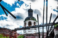 The old destroyed abandoned church. Blue sky. Old brick ruined abandoned church Royalty Free Stock Photos