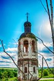 The old destroyed abandoned church. Blue sky. Old brick ruined abandoned church Stock Photography