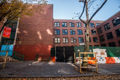 Old Brick School Building Under Construction in Manhattan. Daytime remodeling. Public school in the heart of manhattan. Education learning center from royalty free stock image