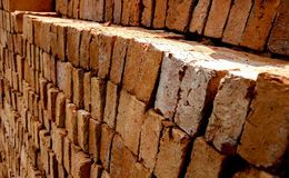 Old brick. Stack of broken orange old brick, selective focus Royalty Free Stock Photo