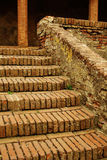 Old brick stairs and columns. In Tuscany with moss Royalty Free Stock Images