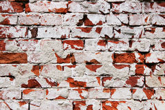 Old brick stone wall. With lots of cracks Stock Photo