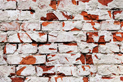 Old brick stone wall. With lots of cracks Royalty Free Stock Photos
