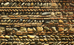 Old brick stone wall mosaic background Royalty Free Stock Images
