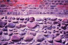Old brick and stone wall, Ultra Violet color toned. Old brick and stone wall, Ultra Violet color toned image Royalty Free Stock Image