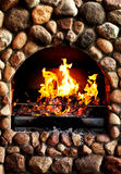 Old brick stove with glowing fire Stock Image