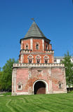 Old brick tower. With a pointed roof and gates stock photos