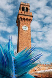 Old brick tower and blue glass of Murano Stock Photos