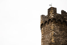 Old brick tower with flag over a sky Royalty Free Stock Images
