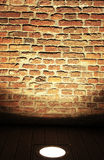 Old brick wall. Illuminated brick wall suitable for backgrounds royalty free stock image