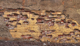 Old brick wall. With cracked stucco layer background Stock Photo