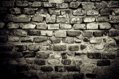 Old brick wall. Dirty old brick wall background Stock Images