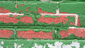 Old Brick Wall. A background of an old brick wall with peeled green paint royalty free stock photos