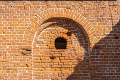 Old brick wall with arch stock image