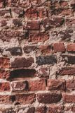 Old Brick Wall Background. Antique wall with red bricks stock photo