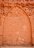 Old Brick Wall Background. Of baked mud bricks with an archway Royalty Free Stock Photo