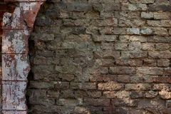 Old Brick wall background. Old Brick dilapidated wall background with sunlight Stock Image