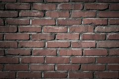 Old brick wall background dark night texture flat front view. Old brick wall background flat dark Stock Photos