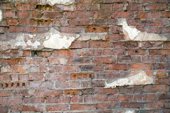 Old brick wall background with fragments of old plaster Backgrounds. Graphic design  textures royalty free stock images