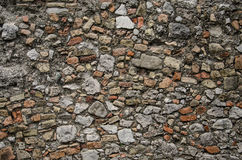 Old brick wall background with gray tone. Old wall background with stone, concrete and brick fragments Stock Images