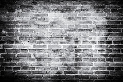 Old brick wall background. Grunge texture. Black wallpaper. Dark royalty free stock photo