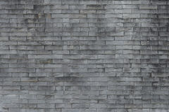 Old brick wall background. Grunge texture. Black wallpaper. Dark. SurfaceAbstract weathered texture stained old stucco light gray and aged paint white brick Stock Images